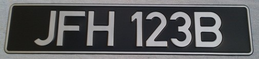 Classic German Silver DIN Font on black plate (Single)